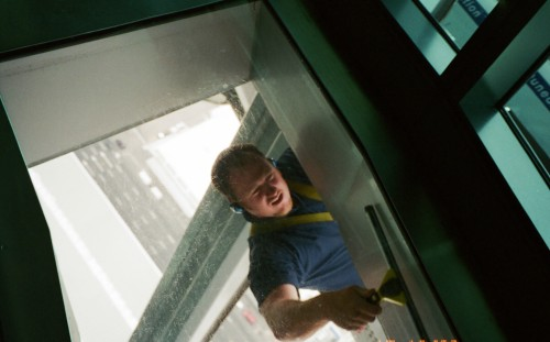 Window washer through the glass floor