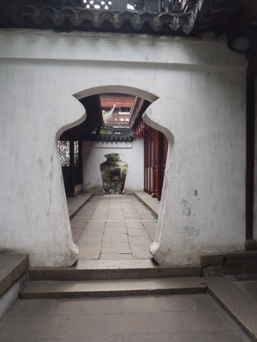 Yuyuan Gardens courtyard through vase openings